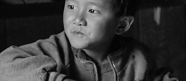 Nepali boy eating dhal bath